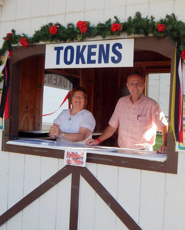 man and woman selling tokens